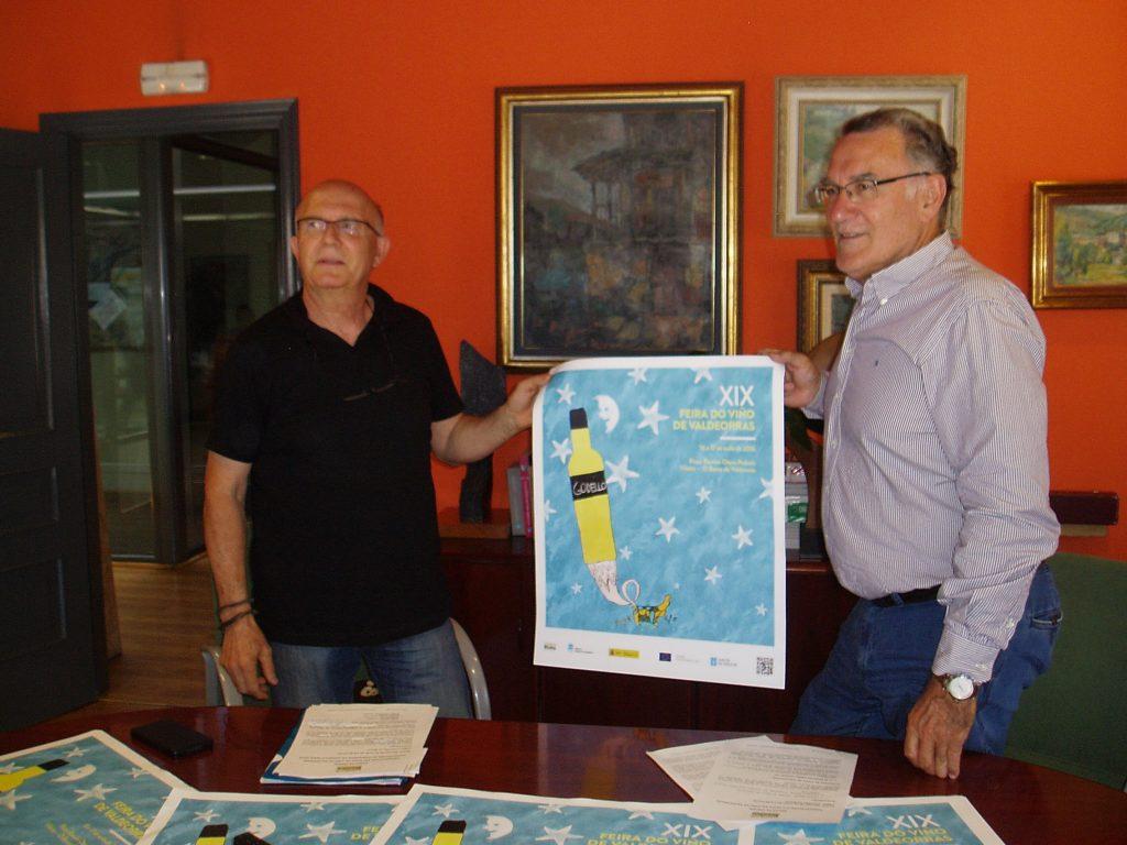 Francisco García y Alfredo García con el cartel de la feria